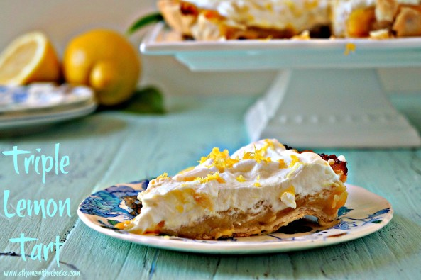 Triple lemon tart is a delicious and easy summer dessert. Layers of tart lemon curd and lemon pudding nestled into a flaky crust, with a topping of freshly whipped cream.