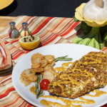 Pistachio-Crusted Chicken, Curry Sauce with Sea Salt Rosemary Garlic Chips