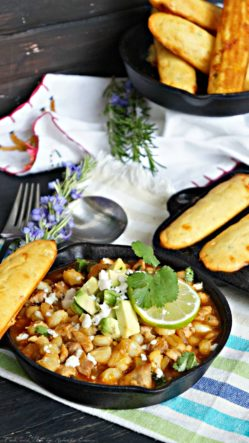 Southwestern Posole Stew with Jalapeño Cheddar Corn Sticks is a hearty and spicy pork stew dinner.