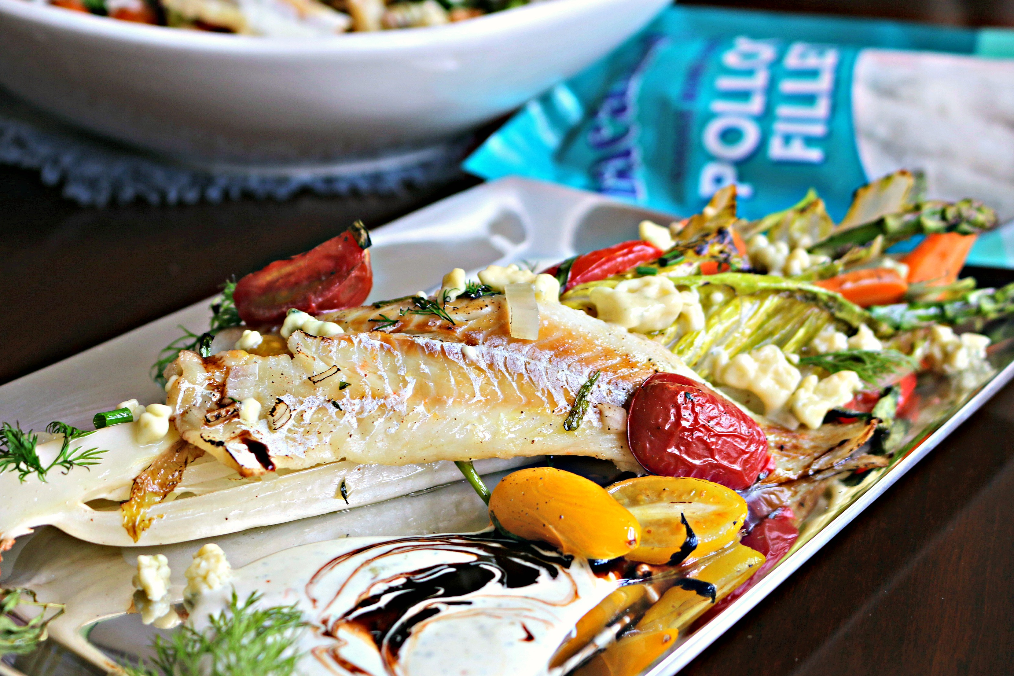 Alaskan pollock fillets with grilled romaine salad is a delicious, healthy, and easy grilled fish dinner. The perfect summer grilling recipe!